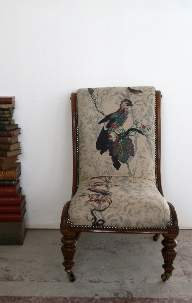 Bird and floral print textile design on chair