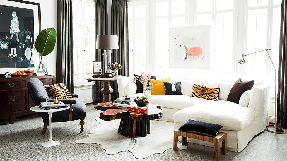 Living room sofa and chairs with animal rug