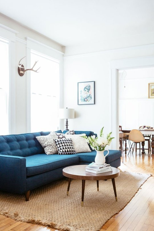 Blue couch living room with monotone colour palette