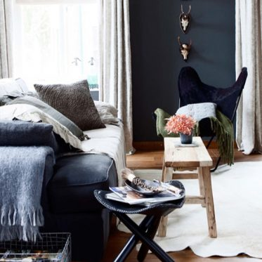 living room soft furnishings and rustic wooden table