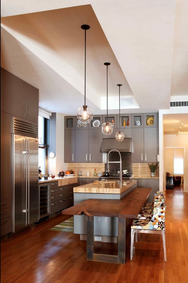 kitchen with hanging light pendants over kitchen island