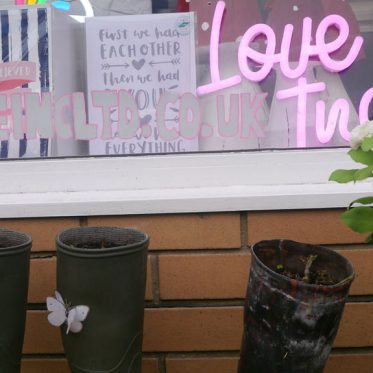 Love Inc. Shop sign