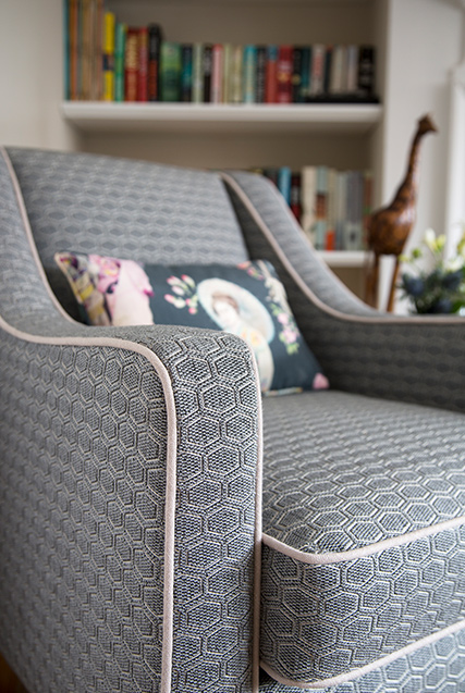 Armchair with patterned texture material and illustrated cushion