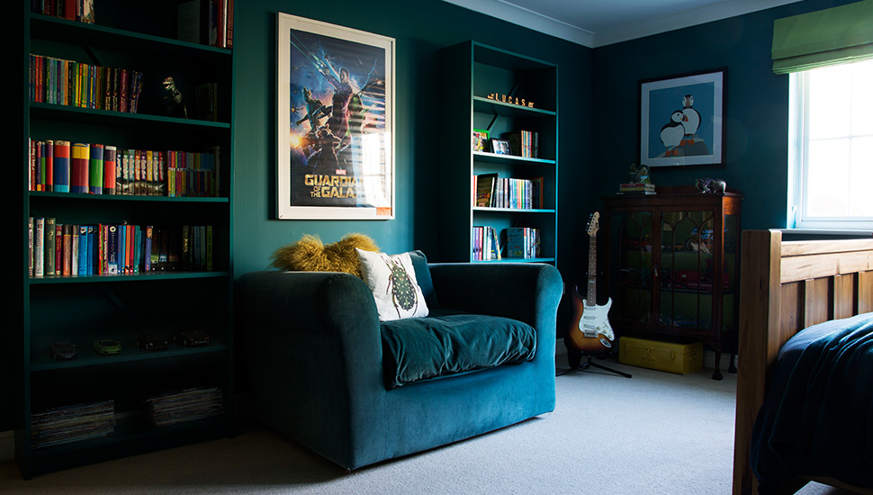 Childrens bedroom sofa and teal wall