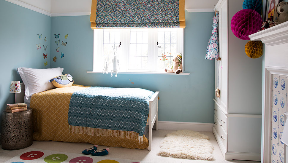 childrens room dressed bed with roman blind print