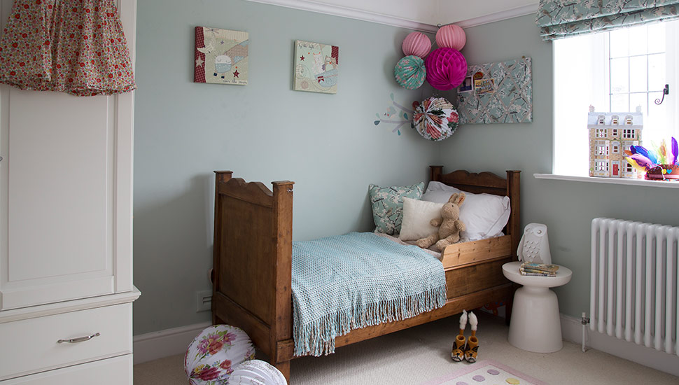 children's room dressed bed and paper pom poms