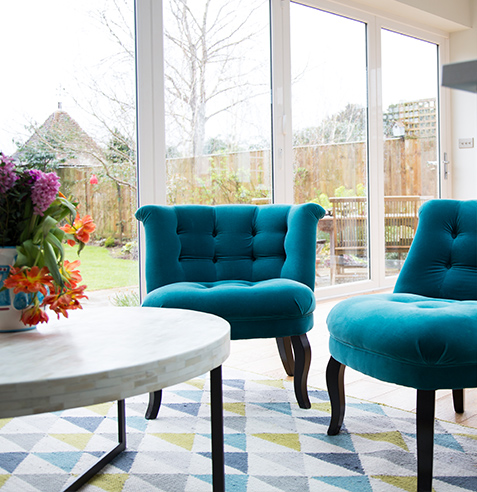dining room teal arm chairs and geometric floor rug
