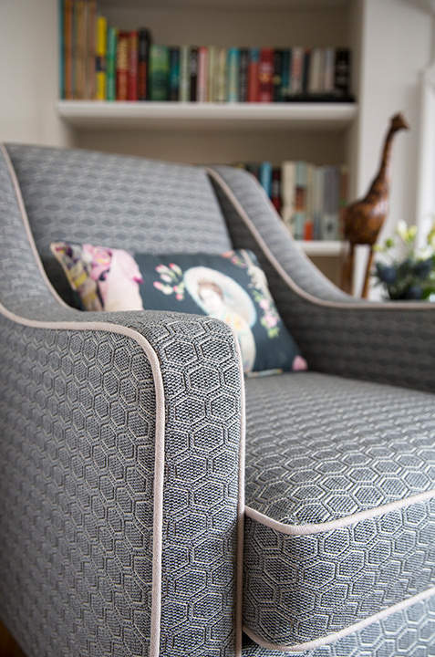 Armchair upholstered grey textile