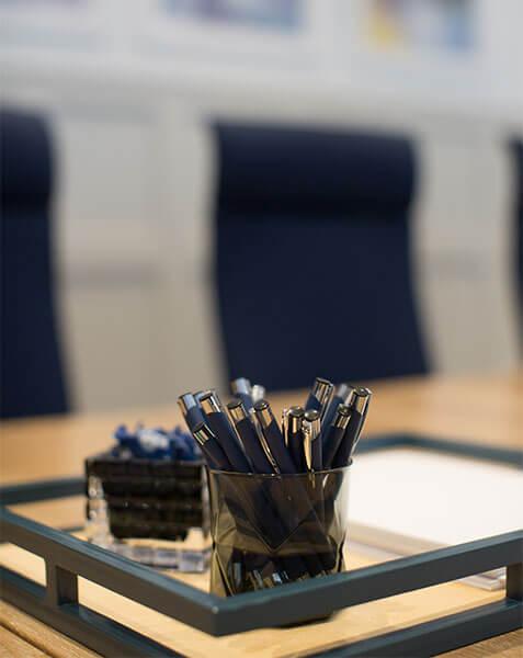 elegant glass pot with navy pens