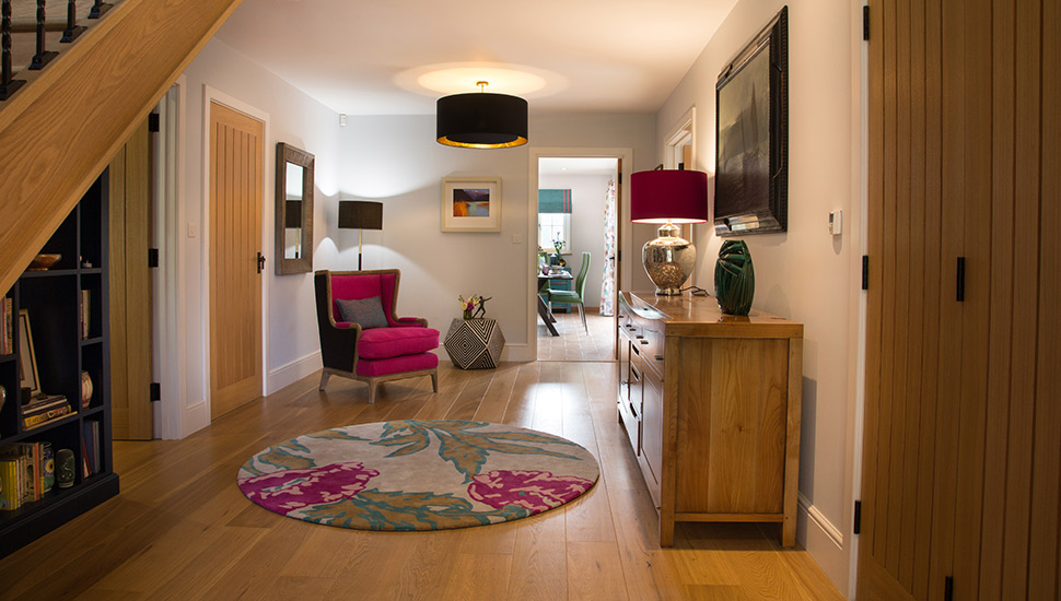 Entrance hall interior design, pink, teal and oak