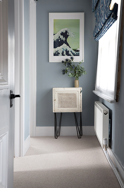 hallway with picture and plant in pot