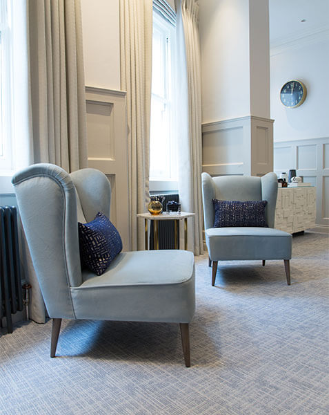 light blue armchairs with navy cushions