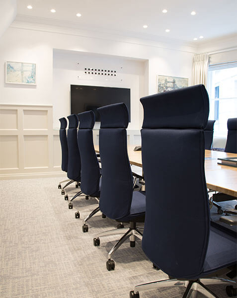 light conference room with navy chairs at table