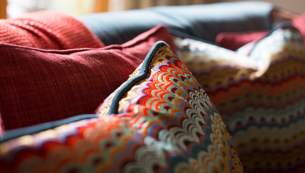 embroidered cushion on living room sofas