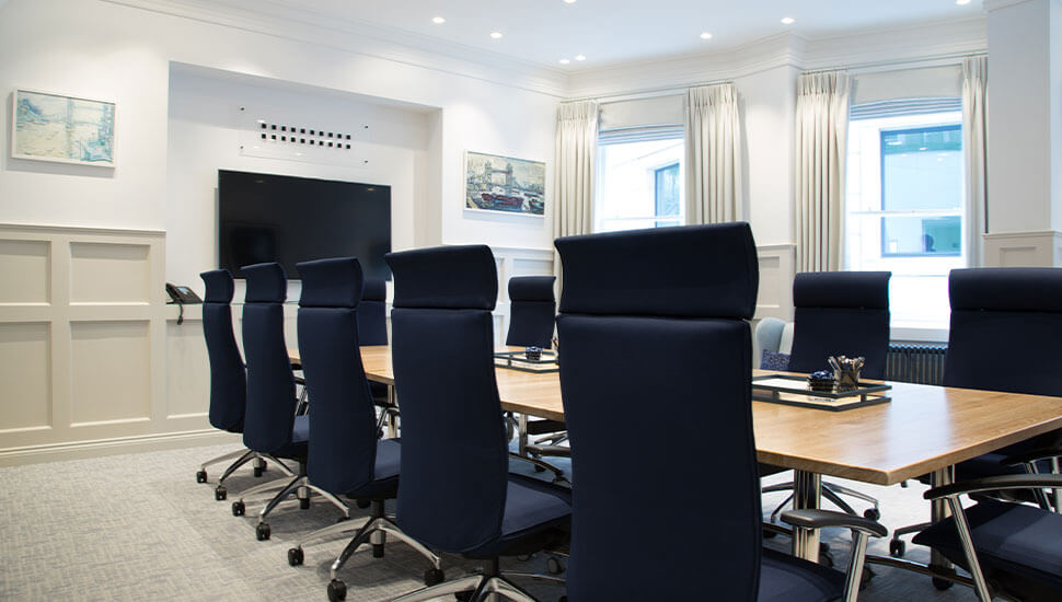 navy boardroom chairs at conference table