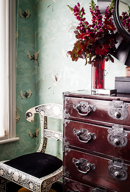 Sideboard with floral bird wallpaper