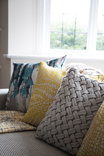mixture of textured coloured cushions