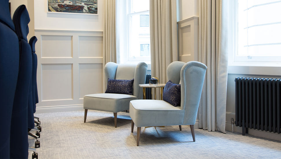 two soft armchairs with navy blue cushions