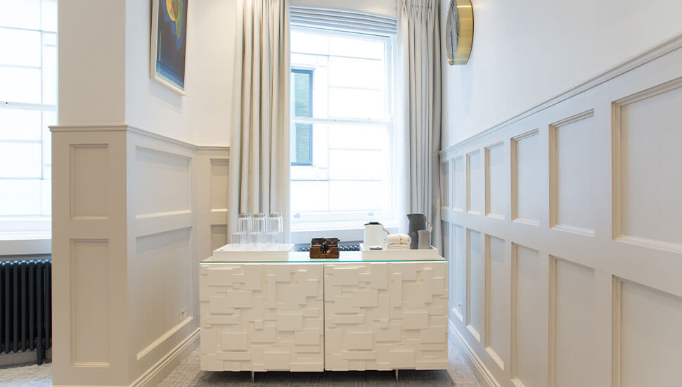 white cabinet in alcove of room