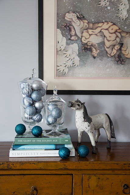 Bonbon jar with lights and decorations next to horse ornament