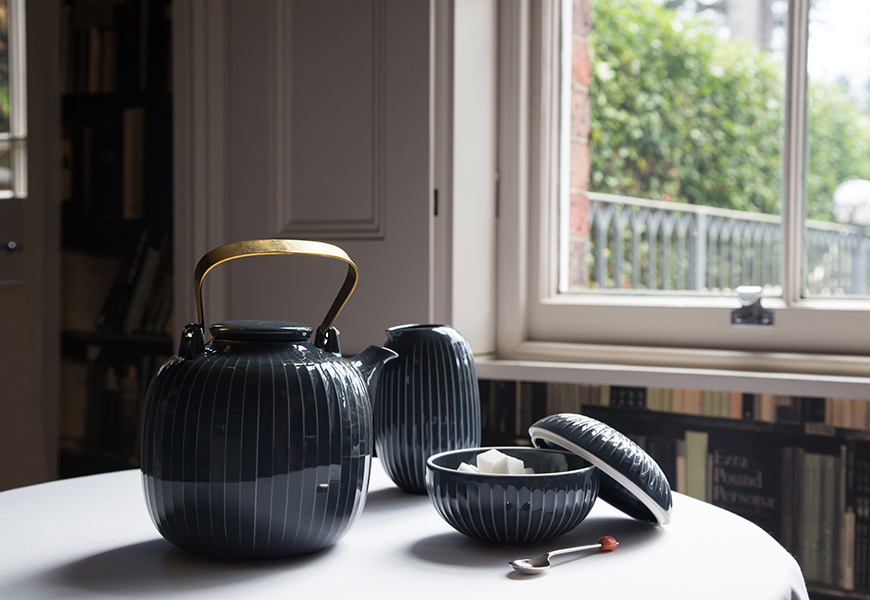 Hammershøi Teapot, Jug and Bonbonniere in Anthracite on table in front of window