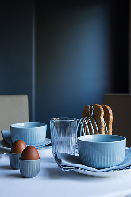 close up of table set for break with eggs and toast. Hammershøi Tumblers in Indigo, Hammershøi Bowls in Sky Blue and Hammershøi Egg Cups in Marble.