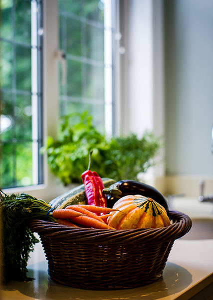 red pepper, carrots, aubergine and a squash in basket