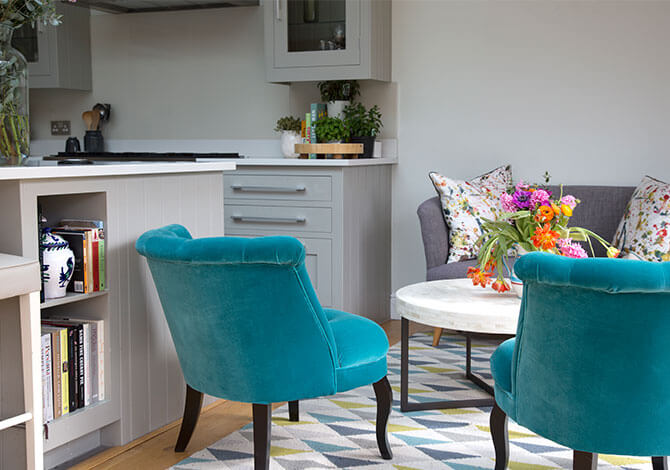 blue velvet armchairs in sitting area