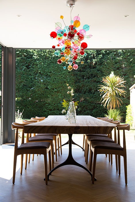 dinning room table with colourful chandelier