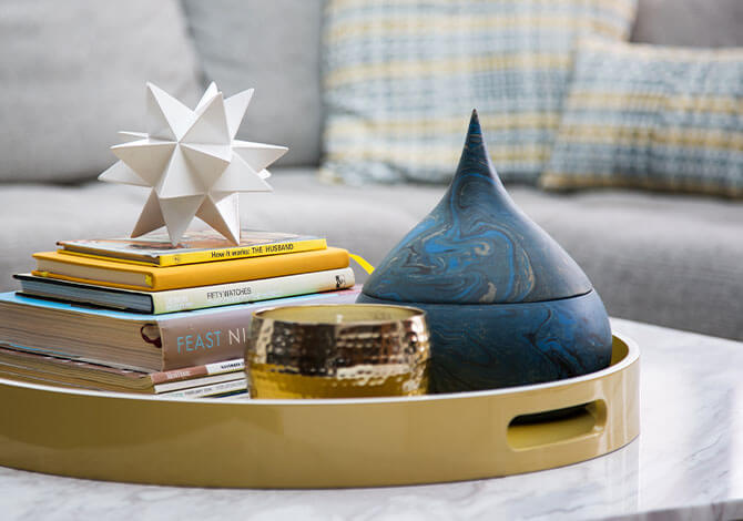 ornaments and books on tray on table