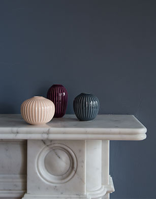 three pots on marble fire place
