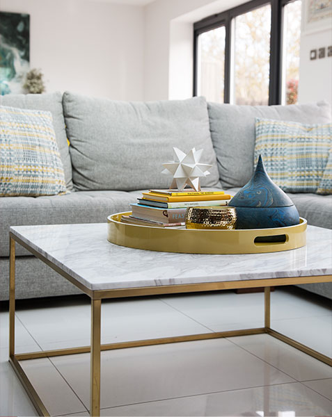 coffee table with gold tray and books