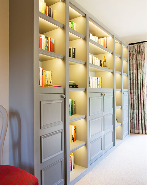grey full height bookcase with display lighting