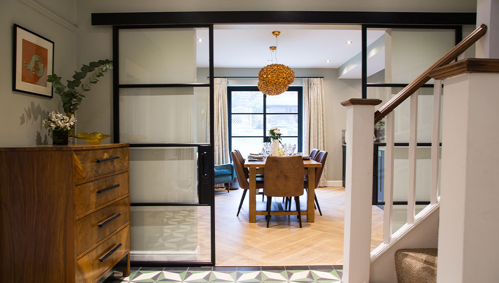 hallway with large glass french doors leading to kitchen