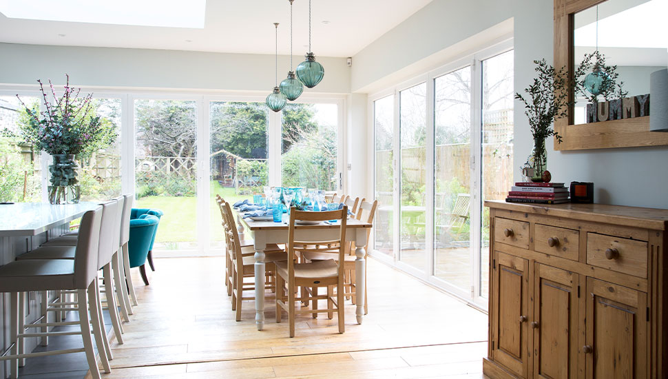 large kitchen and dinning room with dual aspect full length windows