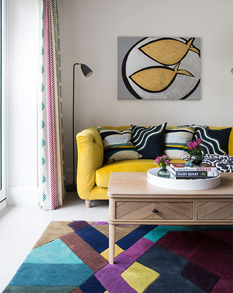 bold geometric rug under coffee table