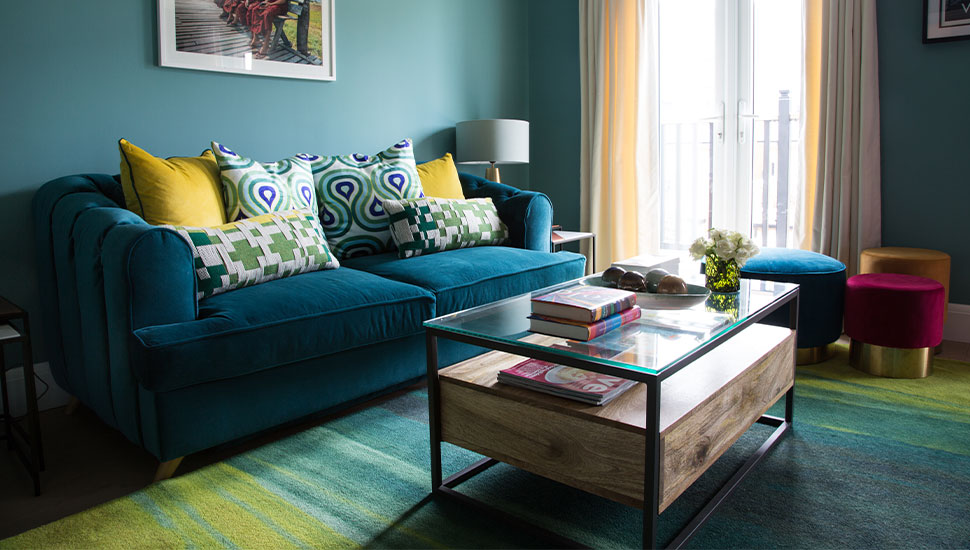 velvet sofa modern coffee table and green rug