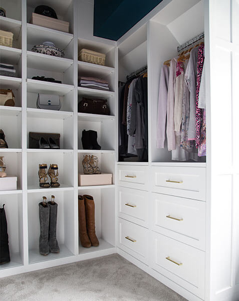 white luxurious walk in wardrobe