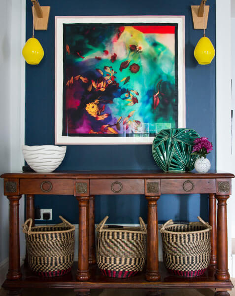 colourful hallway with antique sideboard