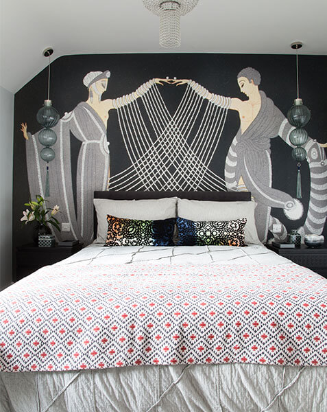 double bed with art deco mural behind bed