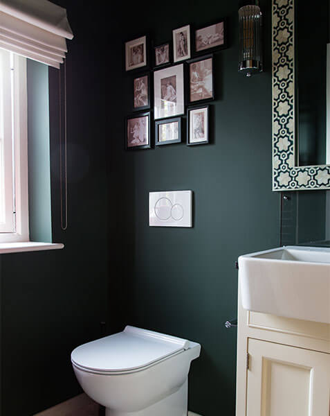 ensuite with dark green walls