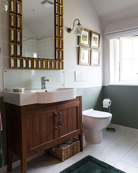 family bathroom with gilt mirror and art deco fixtures