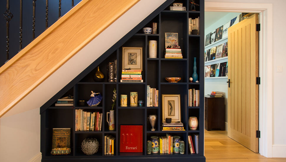 bespoke bookcase fitted under the stairs