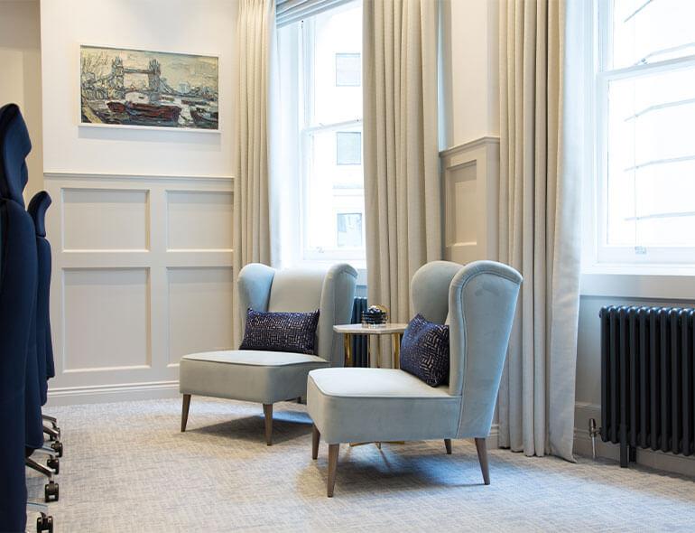 blue soft seating in light elegant room
