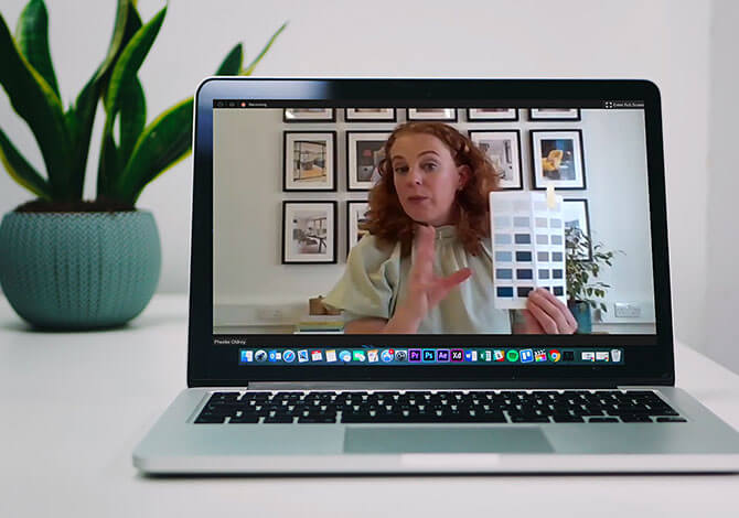 laptop showing phoebe on screen with plant in background